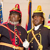 Ordnance Sgt. Madison Walker and Commander Fred Marable discuss the history of the Buffalo Soldiers during a humerous skit.