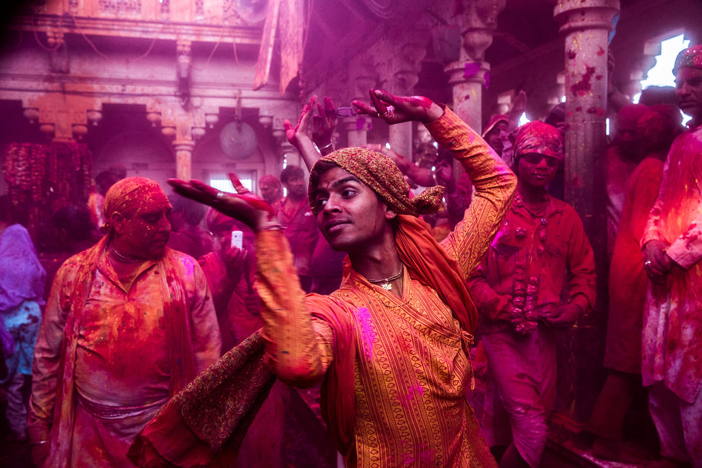 . Hindu devotees play with color during Lathmaar Holi celebrations on March 21, 2013 in the village of Barsana, near Mathura, India. The tradition of playing with colours on Holi draws its roots from a legend of Radha and the Hindu God Krishna. It is believed that young Krishna was jealous of Radha\'s fair complexion since he himself was himself very dark. After questioning his mother Yashoda on the darkness of his complexion, Yashoda, teasingly asked him to colour Radha\'s face in which ever colour he wanted. In a mischievous mood, Krishna applied colour on Radha\'s face. The tradition of applying color on one\'s beloved is being religiously followed till date. (Photo by Daniel Berehulak/Getty Images)