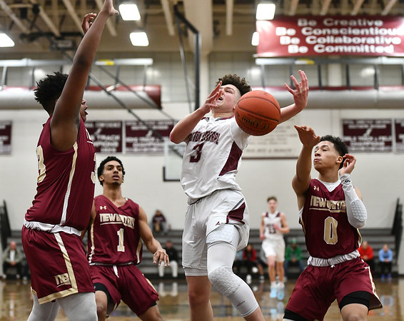 1/3/2020 Mike Orazzi | StaffrBristol Central High School's Damion Glasper (3) and New Britain's Dontay Bishop (33) and Justice Carter (0) during Friday night's boys basketball game in Bristol. r