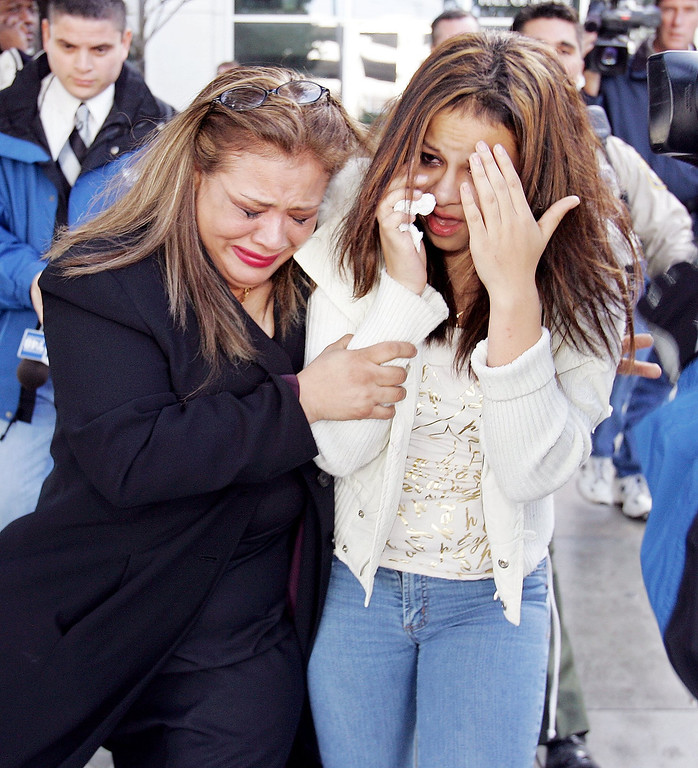 . Anna Ayala\'s sister, Mary Ayala, left, and Anna Ayala\'s daughter, Genesis Reyes, right, leave a Santa Clara County Superior Court in a San Jose, Calif., Wednesday, Jan. 18, 2006 after Ayala and her husband Jaime Plascencia were sentenced. Plascencia and Ayala, who cooked up a scheme last March to plant a severed finger in a bowl of Wendy\'s chili to extort money from the fast food chain, were sentenced to lengthy prison terms.   (AP Photo/Paul Sakuma)