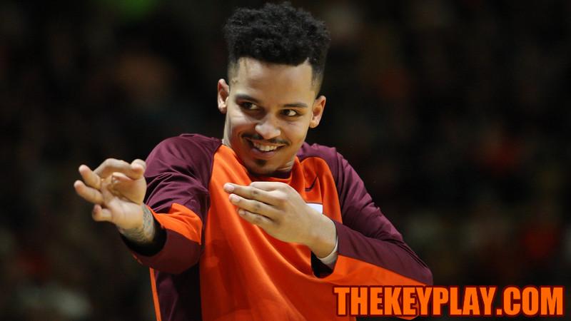 Seth Allen celebrates a three point shot on the bench. (Mark Umansky/TheKeyPlay.com)