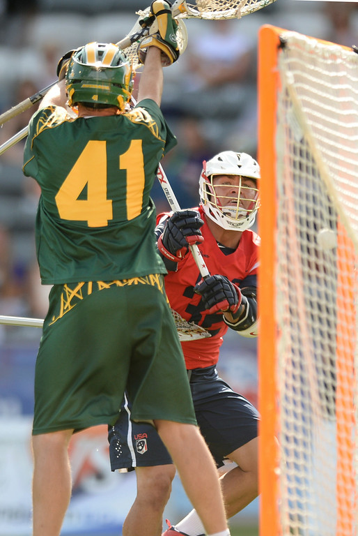 . COMMERCE CITY, CO - JULY 17: US attack Rob Pannell (32) fired a shot past Australia goalie Warren Brown (41) for a goal in the first half. Team USA faced Australia in a FIL World Championship semifinal game Thursday night, July 17, 2014.  Photo by Karl Gehring/The Denver Post