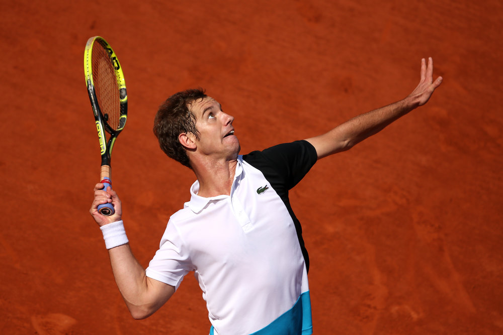 . Richard Gasquet of France serves during his Men\'s Singles match against Stanislas Wawrinka of Switzerland on day nine of the French Open at Roland Garros on June 3, 2013 in Paris, France.  (Photo by Clive Brunskill/Getty Images)