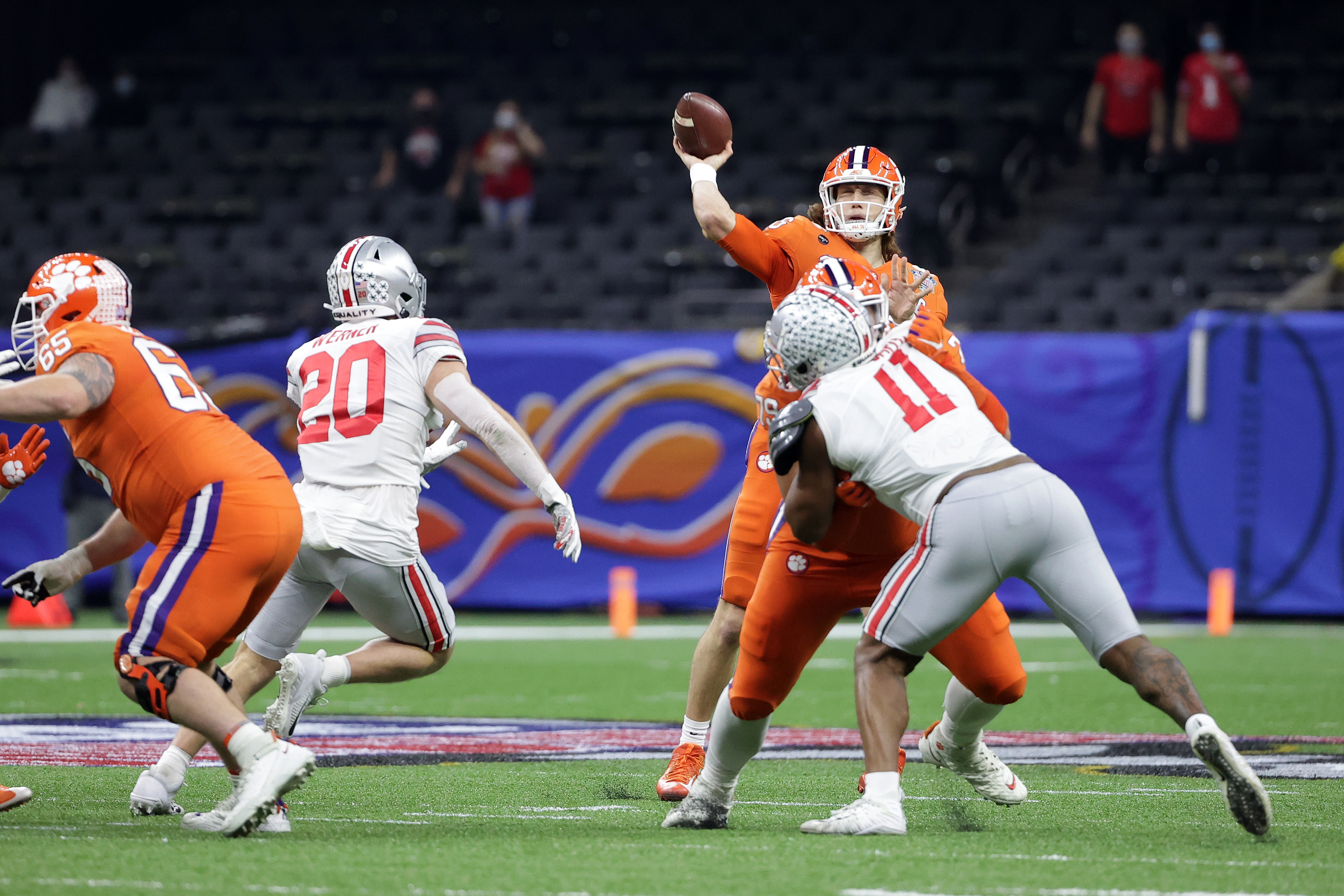 Jan 1, 2021; New Orleans, LA, USA; Clemson Tigers quarterback Trevor Lawrence (16) attempts a pass against the Ohio State Buckeyes during the first half at Mercedes-Benz Superdome. Mandatory Credit: Derick E. Hingle-USA TODAY Sports