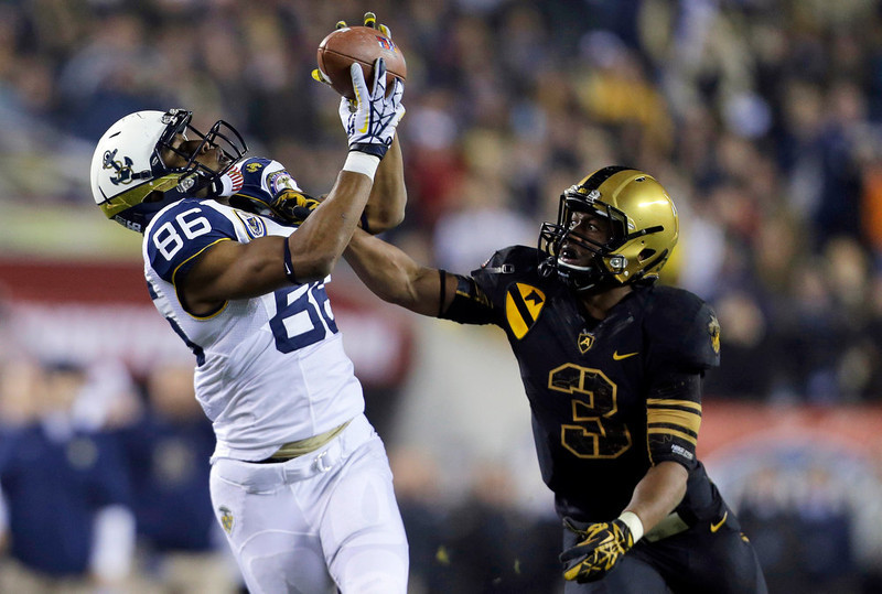 . Navy\'s Brandon Turner, left, catches a pass over over Army\'s Chris Carnegie during the second half of an NCAA college football game Saturday, Dec. 8, 2012, in Philadelphia. Navy won 17-13. (AP Photo/Matt Rourke)