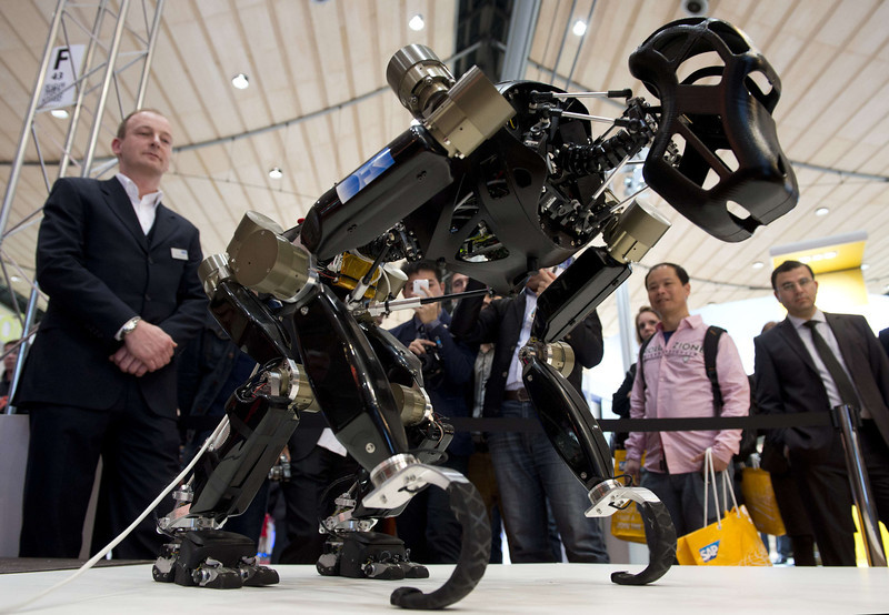 ". The ape-like robotic system ""Charlie\"" walks on all of his four limbs during a demonstration at the 2014 CeBIT computer technology trade fair on March 10, 2014 in Hanover, central Germany. Developed by the German Research Center for Artificial Intelligence (DFKI) and the University of Bremen within the iStruct project (intelligent Structures for mobile robots), the robot could conceivably be used in the kind of rough terrain found on the moon. Great Britain is partner country of the fair considered as the world\'s biggest high-tech fair running from March 10 to 14, 2014. JOHN MACDOUGALL/AFP/Getty Images"