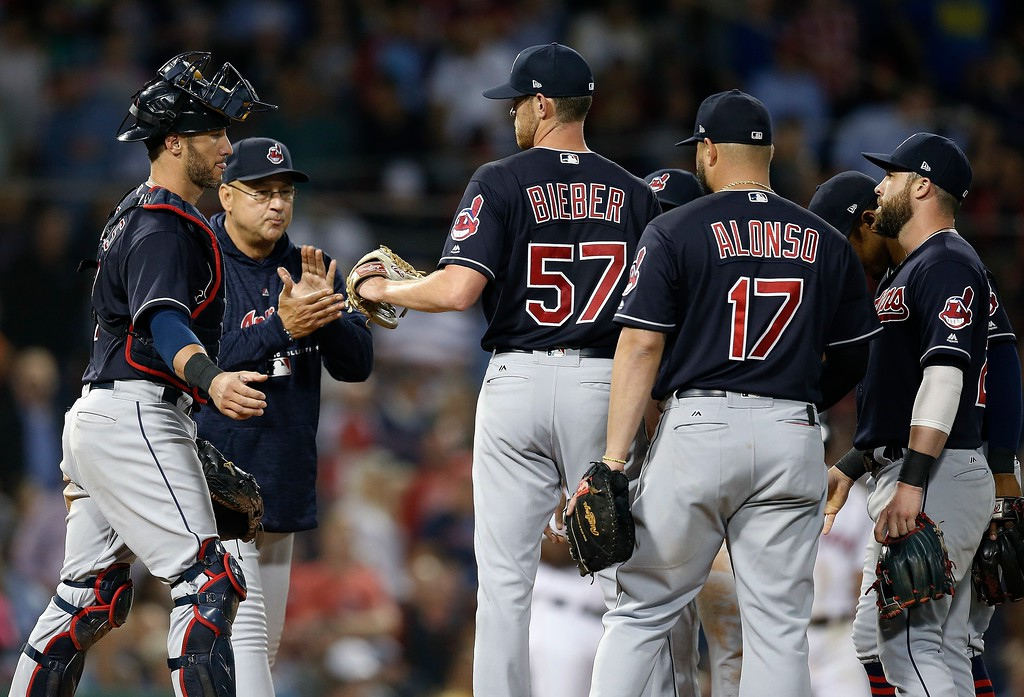 . Cleveland Indians manager Terry Francona, second from left, comes to the mound to relieve Shane Bieber (57) during the seventh inning of a baseball game against the Boston Red Sox in Boston, Tuesday, Aug. 21, 2018. (AP Photo/Michael Dwyer)