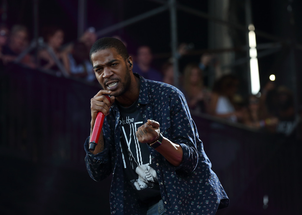 . FILE - In this Aug. 1, 2015, file photo, Kid Cudi performs at the Lollapalooza Music Festival in Grant Park in Chicago. Cudi slammed Kanye West in a series of critical tweets on Wednesday, Sept. 14, 2016. (Photo by Steve C. Mitchell/Invision/AP, File)
