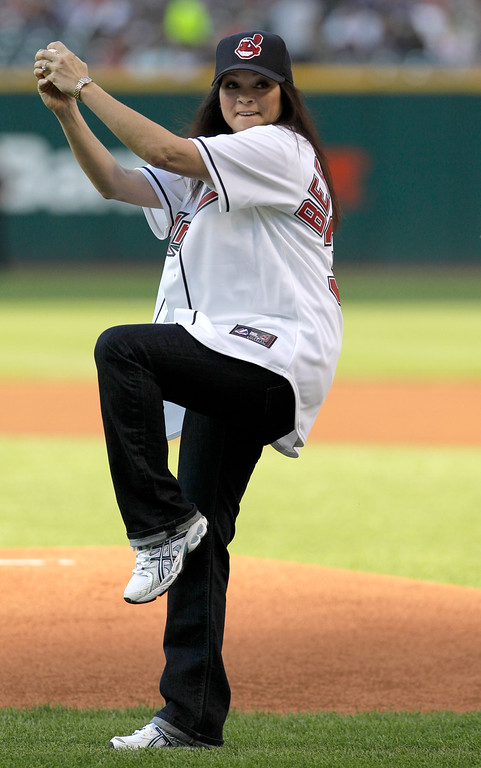 ". Actress Valerie Bertinelli, of the sitcom ""Hot in Cleveland,\"" throws the ceremonial first pitch before the Cleveland Indians face the Pittsburgh Pirates in an interleague baseball game in Cleveland on Friday, June 17, 2011. (AP Photo/Amy Sancetta)"