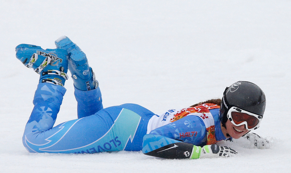 Description of . Slovenia's Tina Maze celebrates her first place finish to win the gold medal in the women's giant slalom at the Sochi 2014 Winter Olympics, Tuesday, Feb. 18, 2014, in Krasnaya Polyana, Russia. (AP Photo/Christophe Ena)
