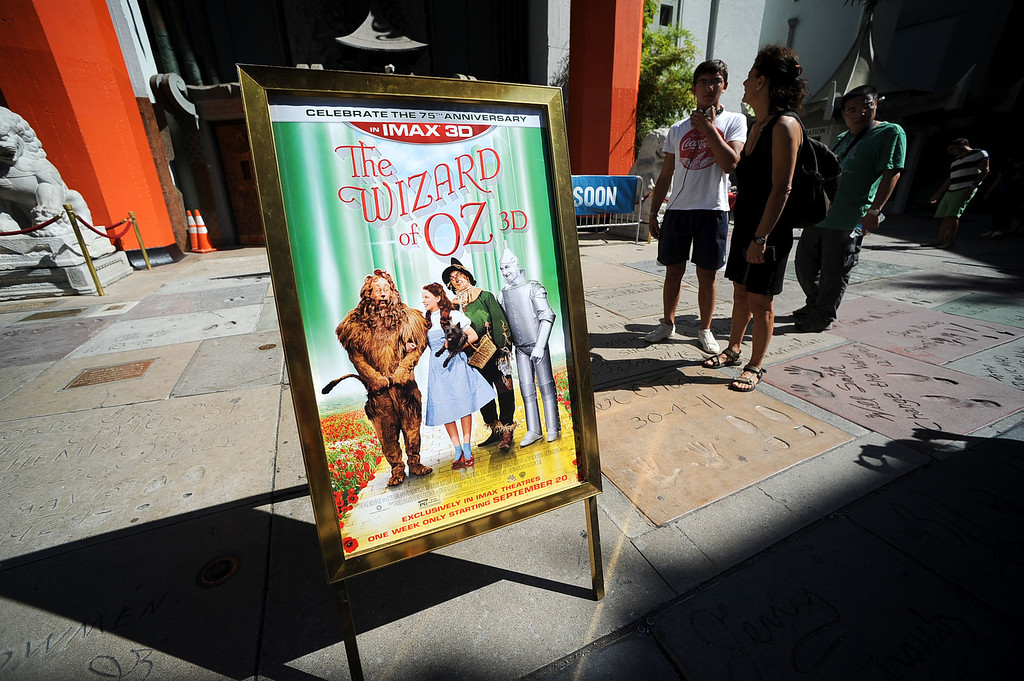 . A sign outside the TCL Chinese Theatre announces the first movie to be shown on the the new 94\'X46\' IMAX screen inside the TCL Chinese Theatre in Hollywood, CA August 23, 2013.  After a summer hiatus, the TCL Chinese Theatre is reopening as the world�s biggest IMAX Theatre with a showing of the Wizard of Oz September 20th.(Andy Holzman/Los Angeles Daily News)