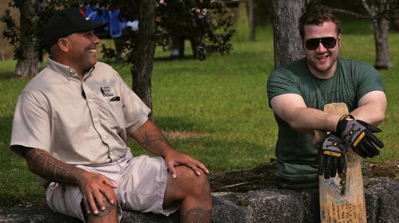 . Kevin chats with his new friend, Warren, before learning how to cliff dive in Hawaii.