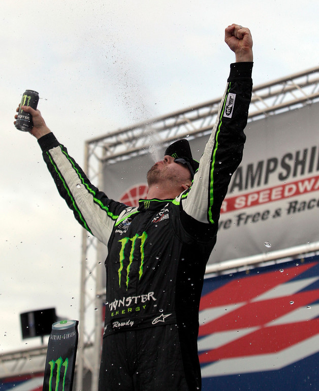 . Kyle Busch celebrates in Victory Lane after winning the NASCAR Nationwide Series auto race, Saturday, July 13, 2013, at New Hampshire Motor Speedway in Loudon, N.H. (AP Photo/Mary Schwalm)
