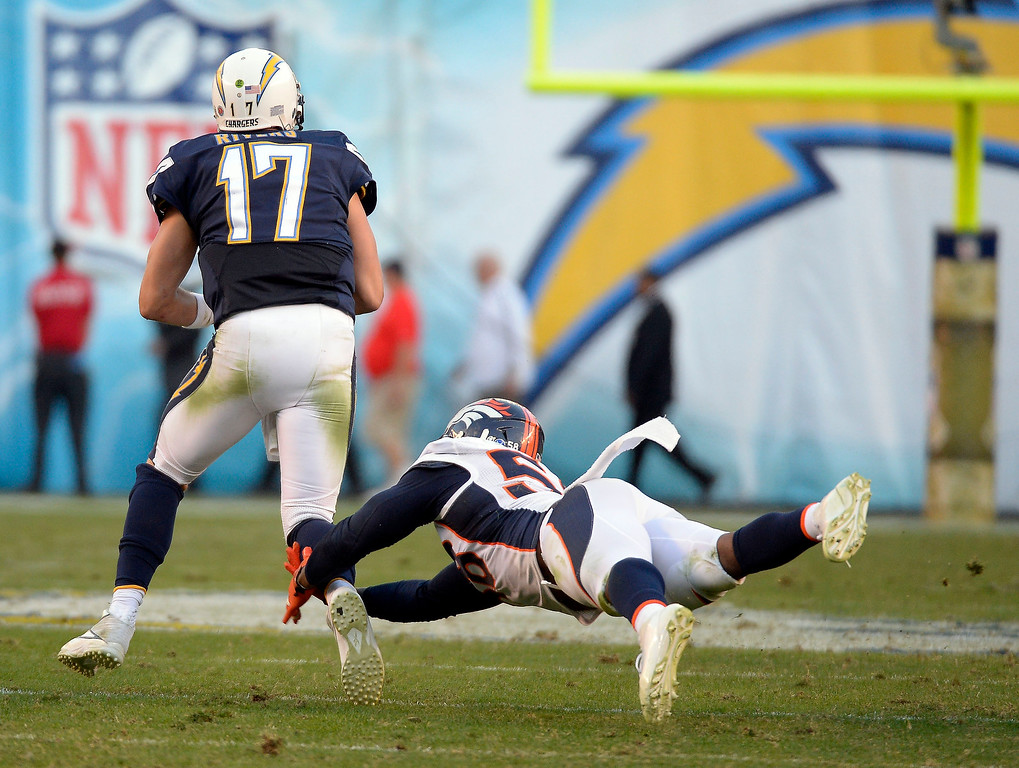 . Denver Broncos outside linebacker Von Miller (58) dives after San Diego Chargers quarterback Philip Rivers (17) and sacks him during the fourth quarter at Qualcomm Stadium. (Photo by John Leyba/The Denver Post)