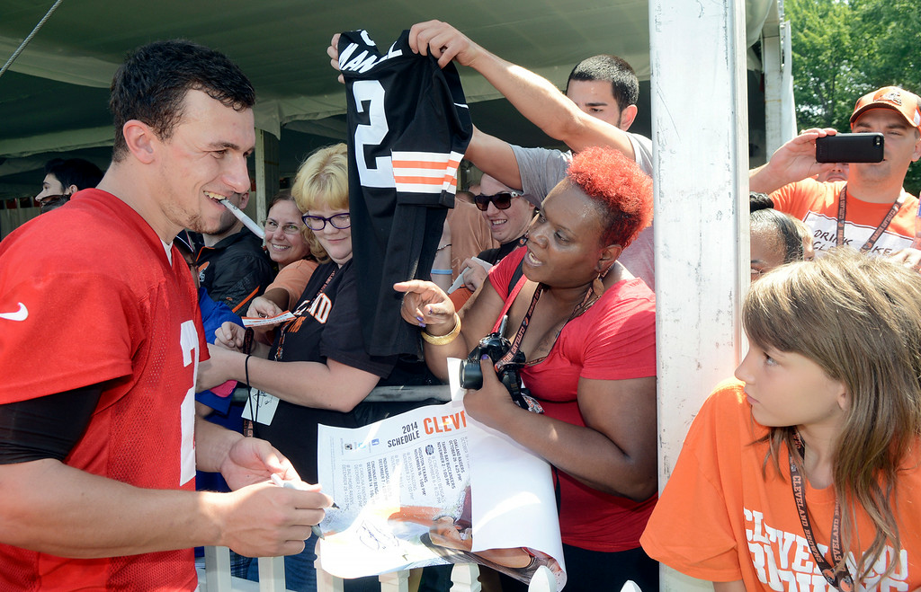 . Duncan Scott/DScott@News-Herald.com Johnny Manziel signs autographs after practice as the Cleveland Browns opened training camp on July 26 at their headquarters in Berea.