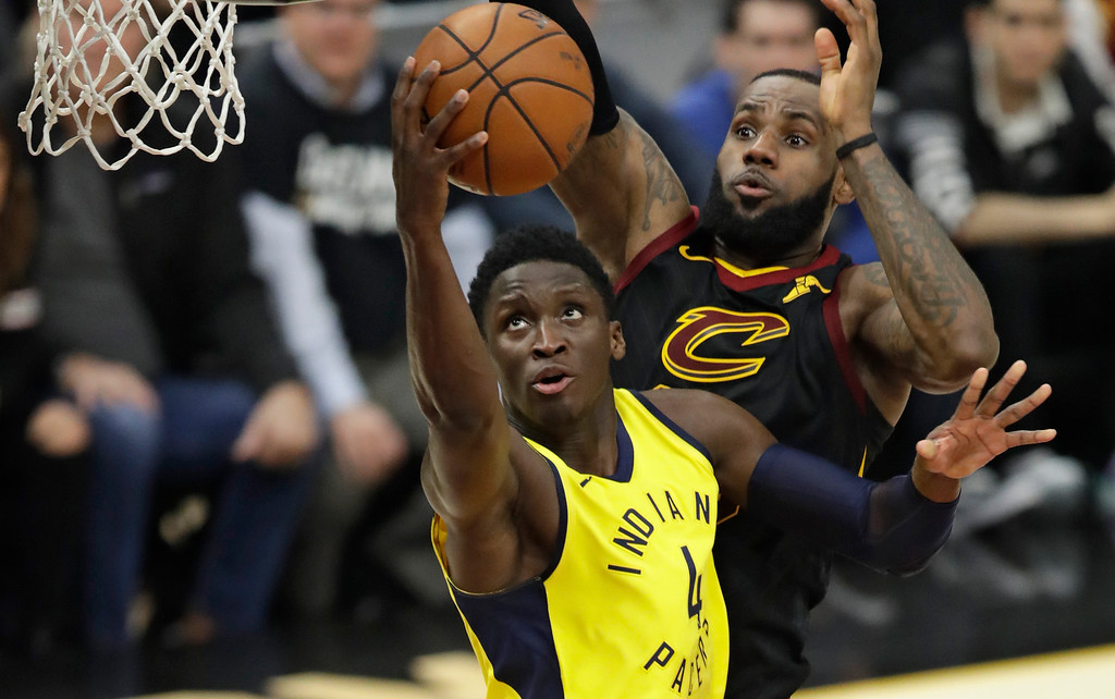 . Indiana Pacers\' Victor Oladipo, left, drives to the basket in front of Cleveland Cavaliers\' LeBron James during the second half of Game 2 of an NBA basketball first-round playoff series Wednesday, April 18, 2018, in Cleveland. The Cavaliers won 100-97. (AP Photo/Tony Dejak)