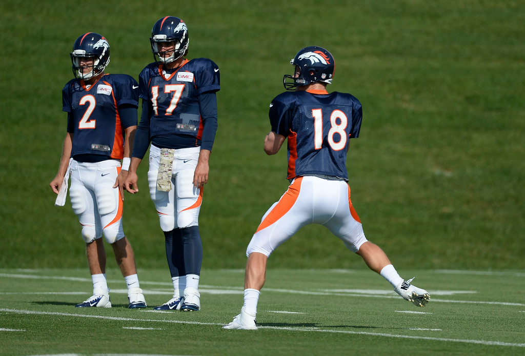 . Denver Broncos quarterback Peyton Manning (18) drops back to pass during drills on day five of the Denver Broncos 2014 training camp July 28, 2014 at Dove Valley. (Photo by John Leyba/The Denver Post)