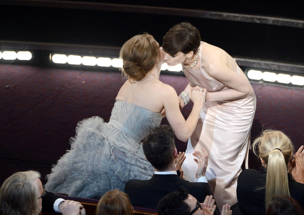 ". Actress Amy Adams kisses actress Anne Hathaway after Hathaway wins the Best Supporting Actress award for ""Les Miserables\"" during the Oscars held at the Dolby Theatre on February 24, 2013 in Hollywood, California.  (Photo by Kevin Winter/Getty Images)"