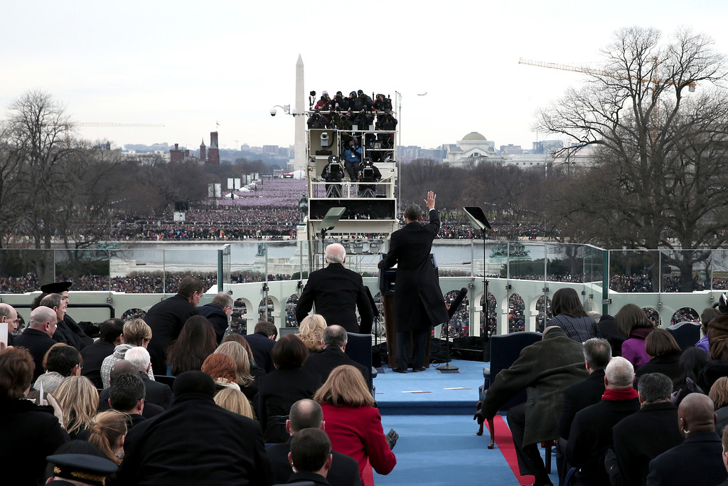 . President Barack Obama waves during his ceremonial swearing-in ceremony during the 57th Presidential Inauguration, Monday, Jan. 21, 2013, on the West Front of the Capitol in Washington.  (AP Photo/Win McNamee, Pool)