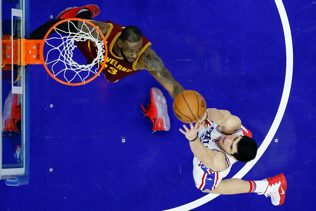 . Cleveland Cavaliers\' LeBron James, left, leaps out of his shoe to chase a rebound against Philadelphia 76ers\' Ersan Ilyasova during the second half of an NBA basketball game, Sunday, Nov. 27, 2016, in Philadelphia. Cleveland won 112-108. (AP Photo/Matt Slocum)