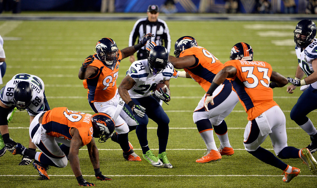 . Seattle Seahawks running back Marshawn Lynch (24) rushes for a first down during the second quarter.  The Denver Broncos vs the Seattle Seahawks in Super Bowl XLVIII at MetLife Stadium in East Rutherford, New Jersey Sunday, February 2, 2014. (Photo by Hyoung Chang//The Denver Post)