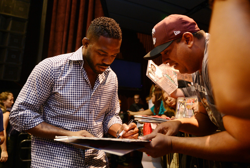 . UFC light heavyweight champion Jon Jones signs autographs for fans during the UFC World Tour at Club Nokia Tuesday, July 30, 2013 in Los Angeles. (Hans Gutknecht/Los Angeles Daily News)