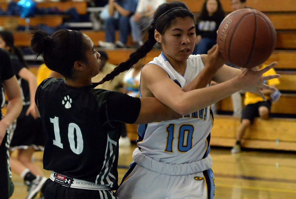 . Walnut\'s Katya Echavez (10) fights for the loose ball with Bonita\'s Nikki Wheatley (C) (10) in the second half of a prep basketball game at Walnut High School in Walnut, Calif., on Wednesday, Jan. 15, 2014. Bonita won 60-50. (Keith Birmingham Pasadena Star-News)