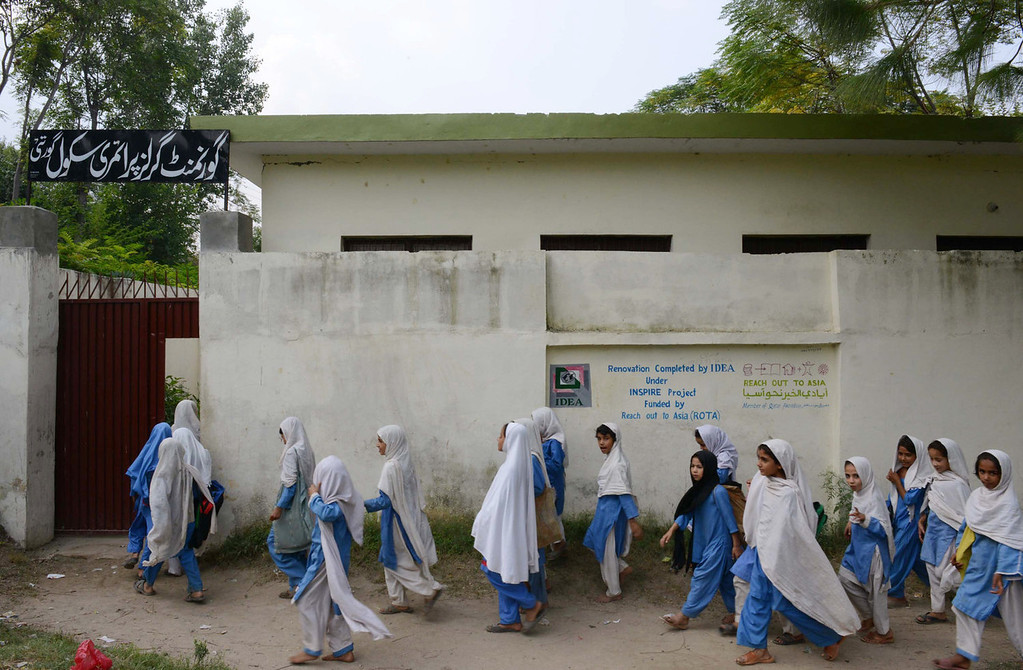 . Pakistani girls arrive for class at a school in Mingora, a town in Swat valley, on October 9, 2013, the first anniversary of the shooting of Malala Yousafzai by the Taliban. Yousafzai, the teenage activist nominated for the Nobel Peace Prize, says she has not done enough to deserve the award, as her old school closed October 9 to mark the first anniversary of her shooting by the Taliban.   A Majeed/AFP/Getty Images