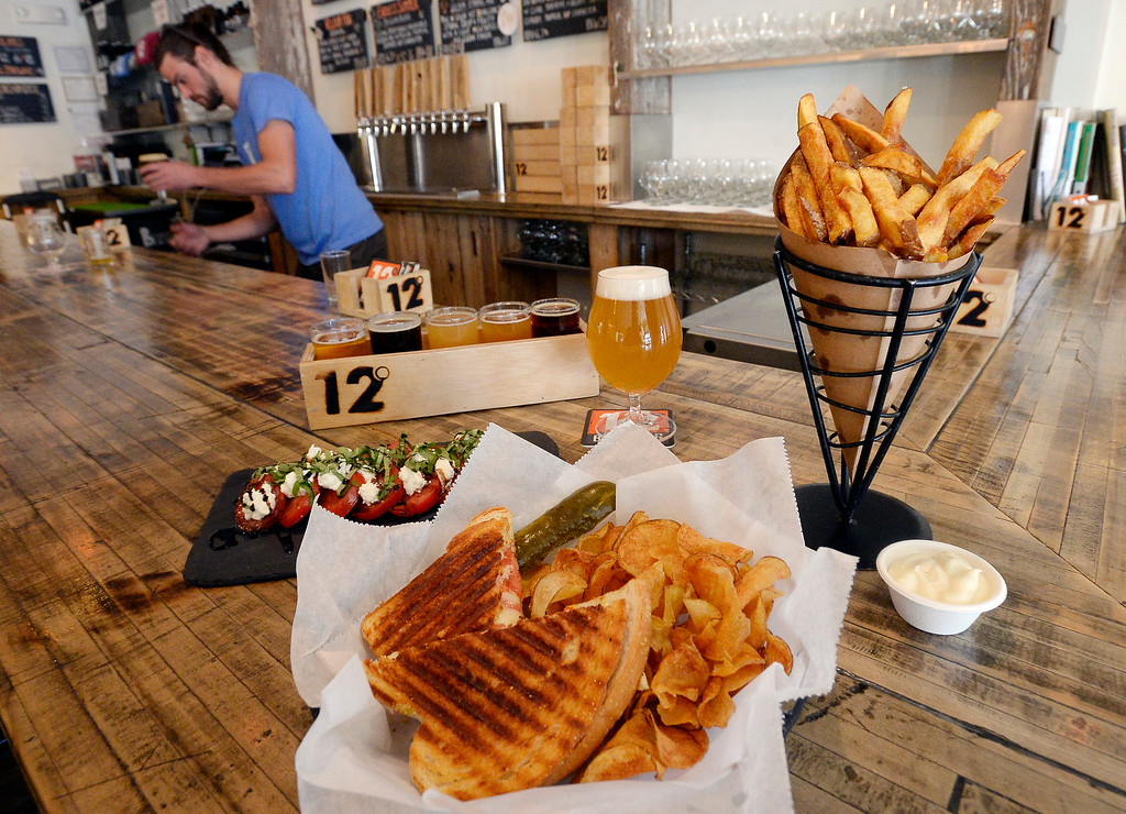 . LOUISVILLE, CO - November 14, 2018:  Frites with garlic mayo, caprese salad, tomato cheddar panini, and a beer flight at 12 Degree Brewery in Louisville.  (Photo by Cliff Grassmick/Staff Photographer)