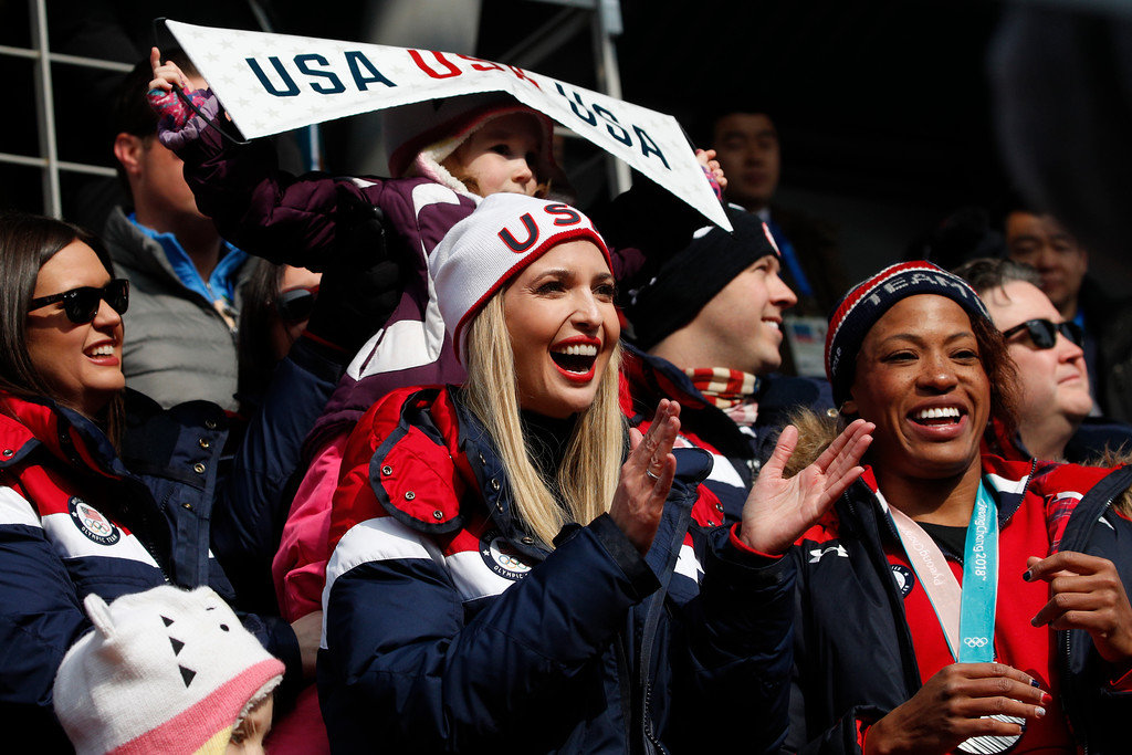 . Silver medalist of the women\'s two-man bobsled, Lauren Gibbs of the United States, right, and Ivanka Trump watch the third heat of the four-man bobsled competition final at the 2018 Winter Olympics in Pyeongchang, South Korea, Sunday, Feb. 25, 2018. (AP Photo/Christophe Ena)