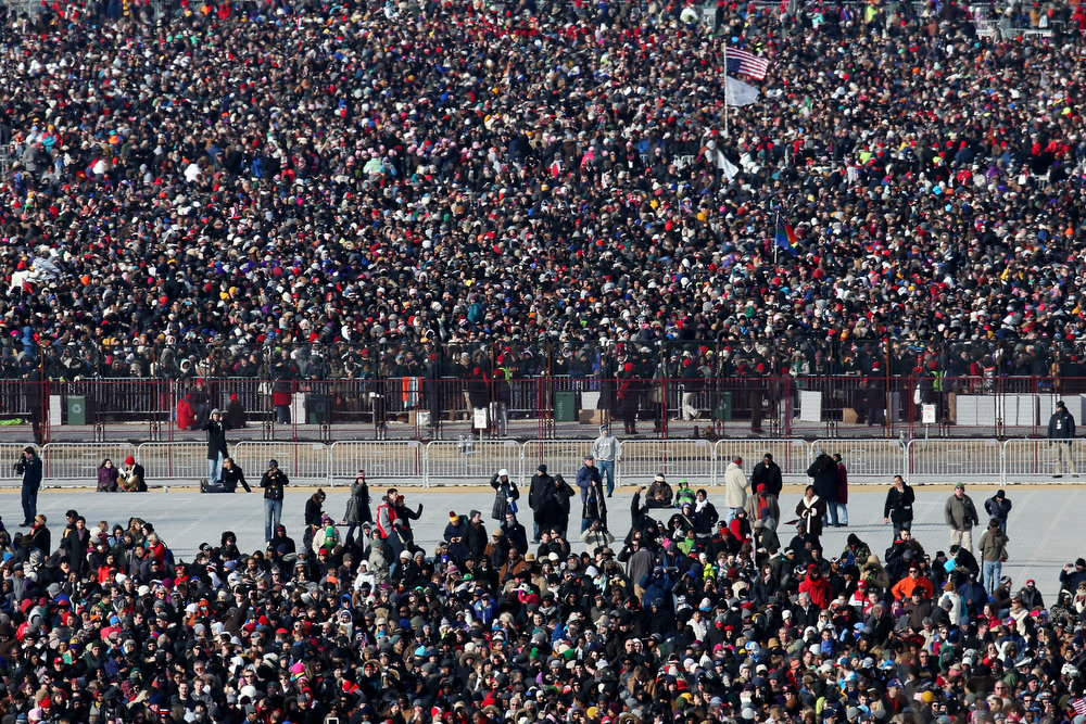 . Crowds wait for the start of the presidential inauguration on the West Front of the U.S. Capitol January 21, 2013 in Washington, DC.   Barack Obama was re-elected for a second term as President of the United States.  (Photo by John Moore/Getty Images)