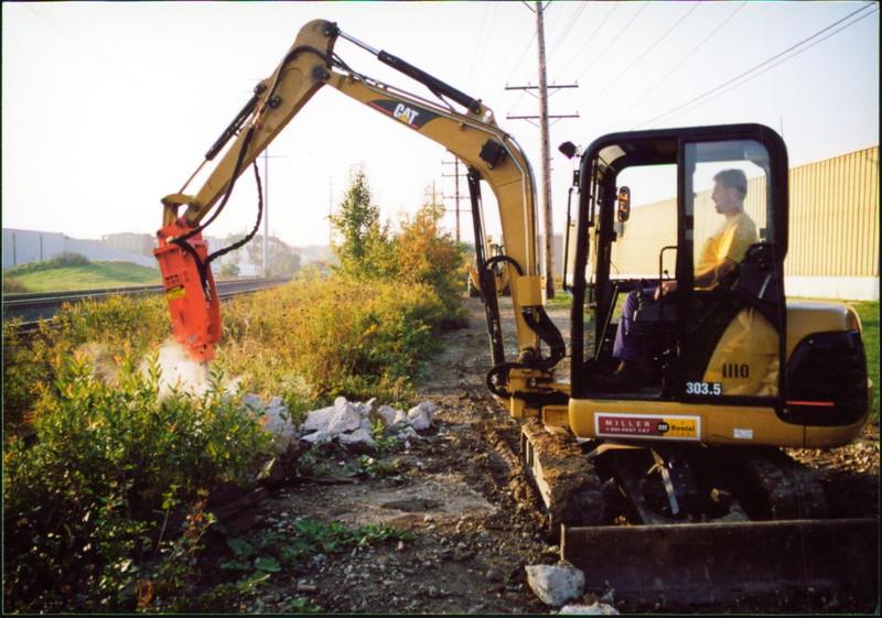 NPK E203 hydraulic hammer on Cat mini excavator at NPKCE (1).JPG