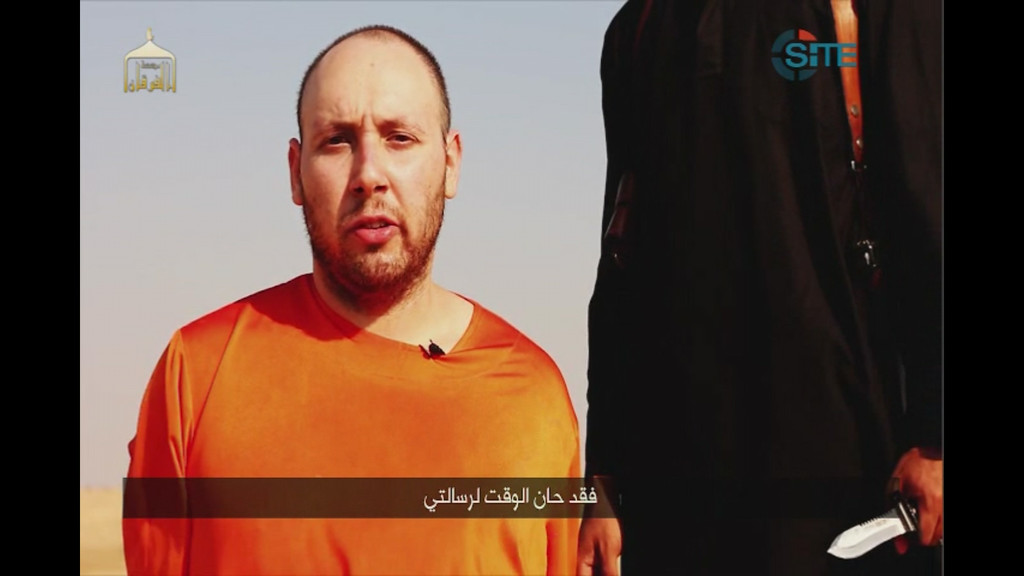 ". This image made from video posted on the Internet by Islamic State militants and provided by the SITE Intelligence Group, a U.S. terrorism watchdog, on Tuesday, Sept. 2, 2014, purports to show journalist Steven Sotloff before he was beheaded. Sotloff had last been seen in Syria in August 2013 until he appeared in a video released online by the Islamic State group on Aug. 19, 2014, that showed the beheading of fellow American journalist James Foley. The Arabic text at the bottom of the frame translates to ""Now is the time for my message.\"" (AP Photo)"