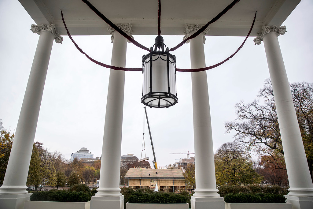 . Construction of the Inauguration Presidential Reviewing Stand is visible from the North Portico of the White House during a preview of the 2016 holiday decor, Tuesday, Nov. 29, 2016, in Washington. (AP Photo/Andrew Harnik)