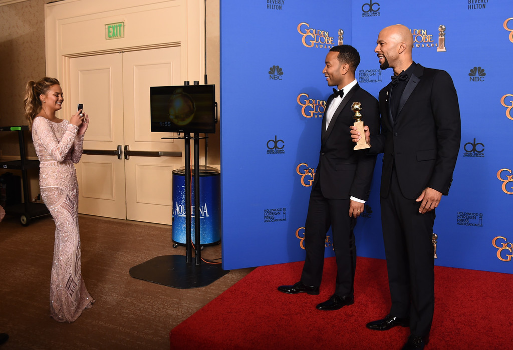 . Chrissy Teigen, from left, John Legend and Common pose in the press room with the award for best original song ìGloryî in a film for ìSelmaî at the 72nd annual Golden Globe Awards at the Beverly Hilton Hotel on Sunday, Jan. 11, 2015, in Beverly Hills, Calif. (Photo by Jordan Strauss/Invision/AP)