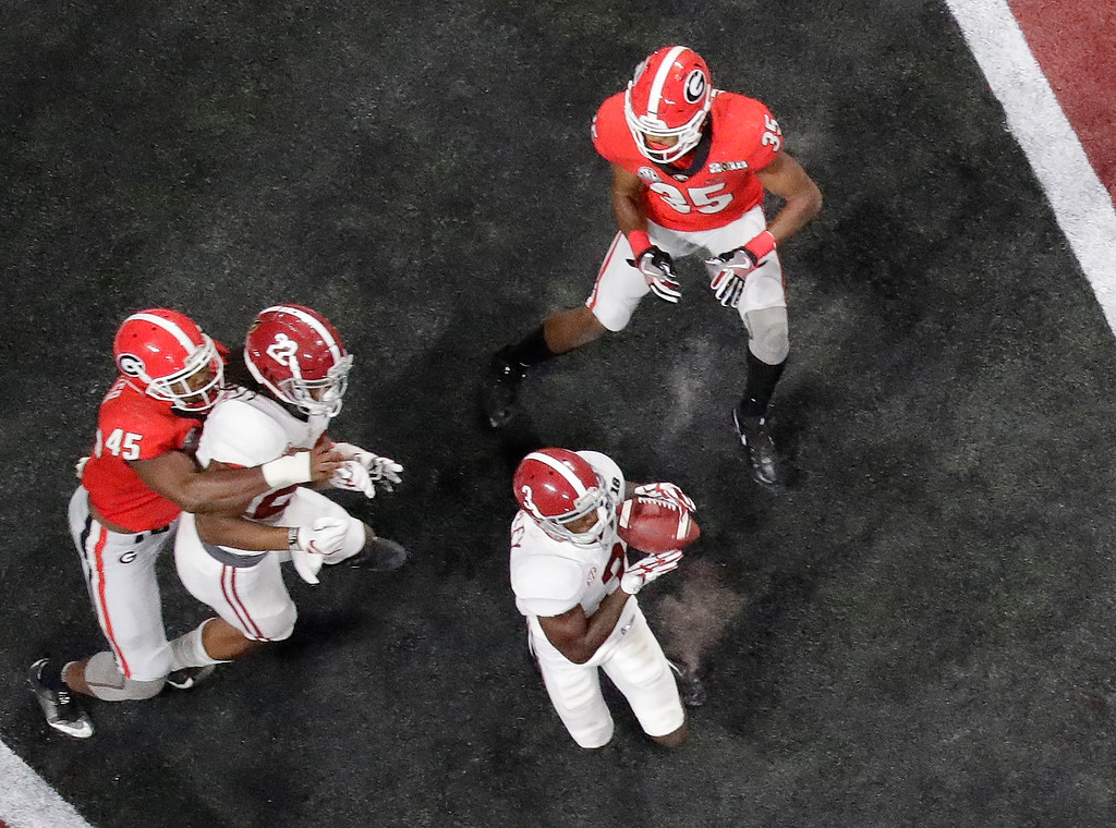 . Alabama\'s Calvin Ridley catches a touchdown pass during the second half of the NCAA college football playoff championship game against Georgia Monday, Jan. 8, 2018, in Atlanta. (AP Photo/John Bazemore)