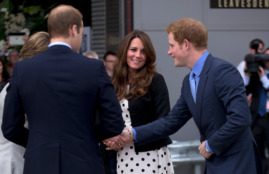 ". Britain\'s Kate the Duchess of Cambridge stands with her husband Prince William, left, and his brother Prince Harry, right, as they are greeted upon their arrival to attend the inauguration of ""Warner Bros. Studios Leavesden\"" near Watford, approximately 18 miles north west of central London, Friday, April 26, 2013. (AP Photo/Matt Dunham)"