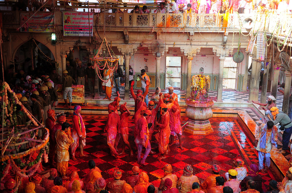 . Indian Hindu devotees dance covered in coloured powder at the Radha Rani temple during the Lathmar Holi festival in Barsana on March 21, 2013. Lathmar Holi is a local celebration, but it takes place well before the national Holi day on March 27. Sanjay Kanojia/AFP/Getty Images