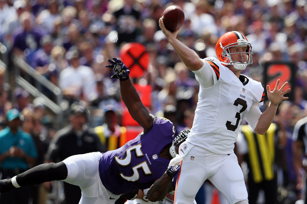 . Quarterback Brandon Weeden #3 of the Cleveland Browns throws a pass while being pressured by outside linebacker Terrell Suggs #55 of the Baltimore Ravens during the first half at M&T Bank Stadium on September 15, 2013 in Baltimore, Maryland.  (Photo by Rob Carr/Getty Images)