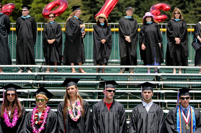 . Graduating seniors line up along a row of bleachers at San Lorenzo Valley High in Felton on Friday during the 2013 graduation ceremony. (Kevin Johnson/Sentinel)