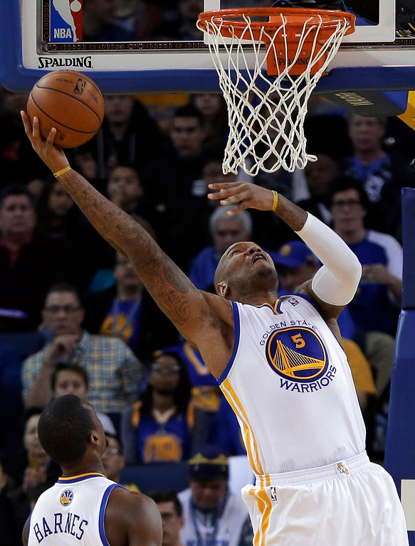 . Golden State Warriors\' Marreese Speights lays up a shot against the Denver Nuggets during the first half of an NBA basketball game on Wednesday, Jan. 15, 2014, in Oakland, Calif. (AP Photo/Ben Margot)