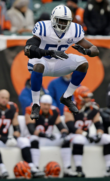 . Indianapolis Colts linebacker Daniel Adongo jumps in the air just prior to receiving a kickoff in the first half of an NFL football game against the Cincinnati Bengals, Sunday, Dec. 8, 2013, in Cincinnati. Adongo is a rugby player from South Africa playing in his first football game. (AP Photo/Al Behrman)