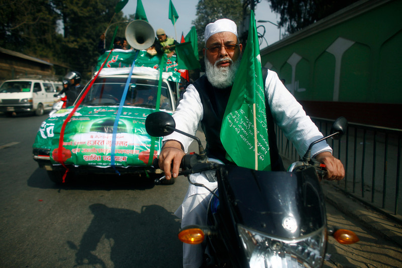 . A Nepalese Muslim man rides his motorbike during a rally to mark Milad-un-Nabi, the festival that commemorates the birthday of Prophet Muhammad  in Katmandu, Nepal, Tuesday, Jan. 14, 2014. Muslims are a minority in this predominantly Hindu Himalayan nation. (AP Photo/Niranjan Shrestha)