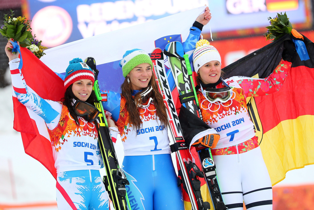 Description of . Anna Fenninger of Austria (silver), Tina Maze of Slovenia (gold) and Viktoria Rebensburg of Germany (bronze) during the flower ceremony for the Women's Giant Slalom at the Rosa Khutor Alpine Center at the Sochi 2014 Olympic Games, Krasnaya Polyana, Russia, 18 February 2014.  EPA/Michael Kappeler