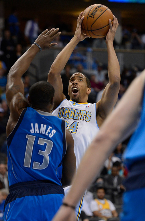 . DENVER, CO. - APRIL 04: Andre Miller (24) of the Denver Nuggets takes a shot over Mike James (13) of the Dallas Mavericks during the first quarter April 4,  2013 at Pepsi Center. (Photo By John Leyba/The Denver Post)