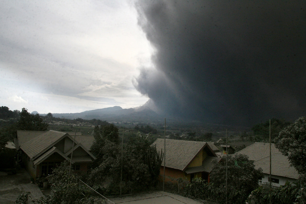 . A massive plume of hot ash clouds spew from Mount Kelud volcano as seen from Malang district in East Java province on February 14, 2014.   AFP PHOTO / AMAN ROCHMAN/AFP/Getty Images