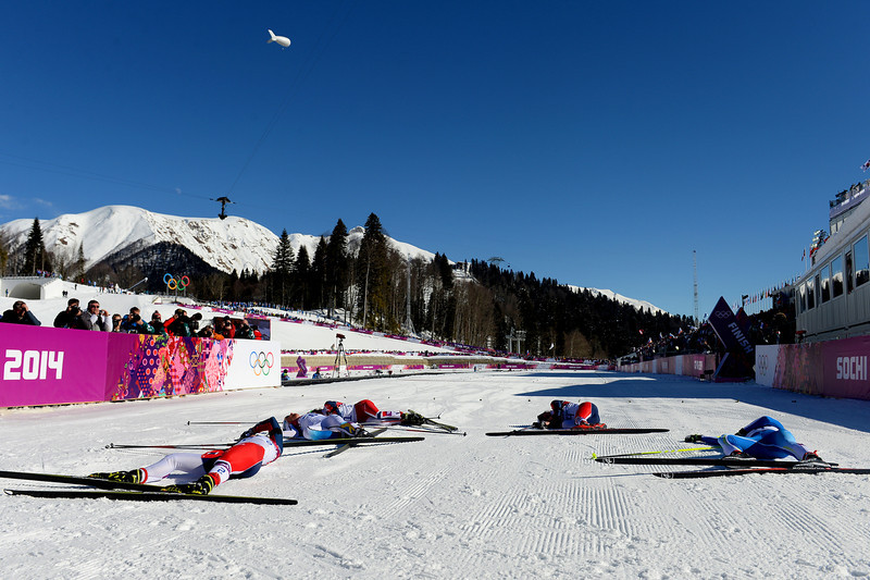 . Competitors lie in the snow next to the finish line after competing in the Ladies\' Skiathlon 7.5 km Classic + 7.5 km Free during day one of the Sochi 2014 Winter Olympics at Laura Cross-country Ski & Biathlon Center on February 8, 2014 in Sochi, Russia.  (Photo by Harry How/Getty Images)