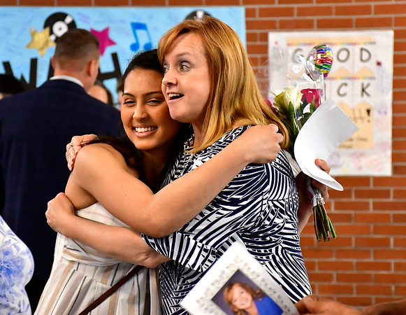 6/11/2019 Mike Orazzi | Staff Sarah Jusa hugs Maureen Brummett during Brummett's farewell reception at Plainville High School on Tuesday.