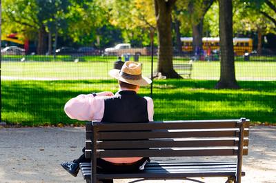 Man relaxing near Wanshington Monument, Washington DC