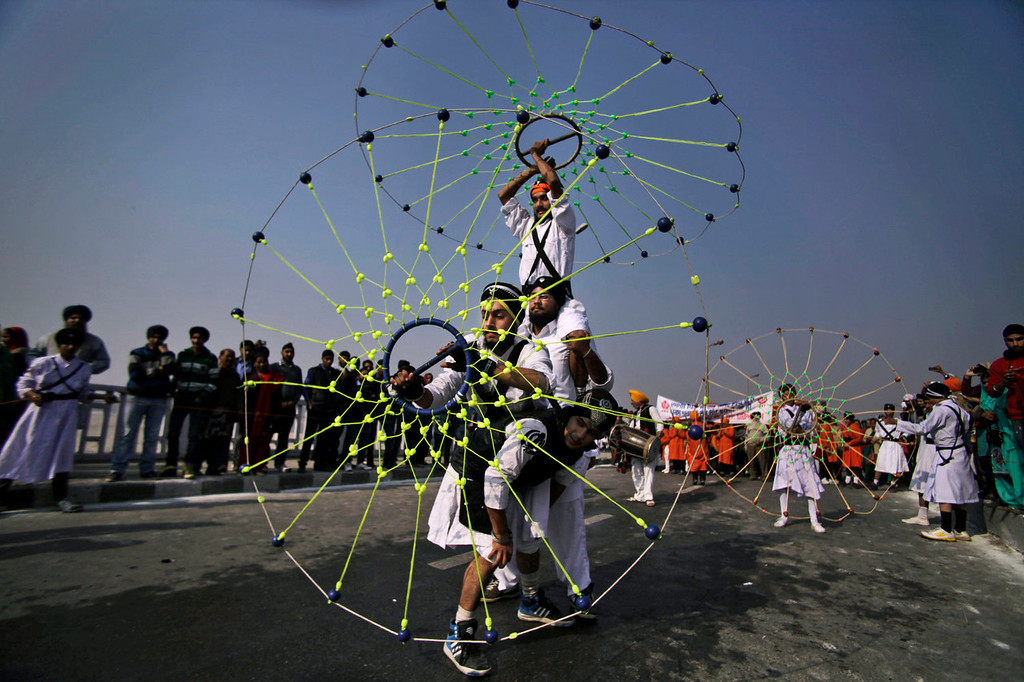 . Indian Sikhs perform the gatka, or Sikh martial arts, during a procession ahead of the birth anniversary of Guru Gobind Singh in Jammu, India, Saturday, Jan. 4, 2014. The birth anniversary of Guru Gobind Singh, the tenth Sikh guru, will be marked on Jan. 7 this year. (AP Photo/Channi Anand)